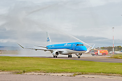 Inverness Airport welcomed KLM's Inaugural flight from Amsterdam. To celebrate the new route, the first flight from Schiphol, Amsterdam was greeted by a water cannon salute upon arrival.  On board were Barry ter Voert, Senior Vice President, Air France KLM European Markets and Wilco Swejen, Director for Aviation Marketing, Schipol Airport.  Provost Helen Carmichael, The Highland Council, Inglis Lyon, Managing Director of Highlands and Islands Aiports and Drew Hendry MP (Inverness, Nairn, Badenoch and Strathspey) met the delegation, officially welcoming the group to the Highlands. <br /> <br /> Pictured: KLM aircraft emerges from under water bridge<br /> <br /> Malcolm McCurrach | EEm | Tue, 17, May, 2016