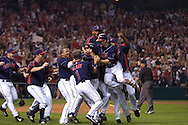David Richard/MLB.com.Cleveland's Travis Hafner is swarmed by his teammates after hitting a game-winning single in the bottom of the 11th inning to score Kenny Lofton in Game 2 of the 2007 ALDS at Jacobs Field in Cleveland.
