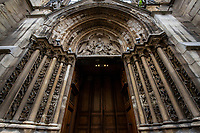 Ornate Paris Door at Saint Severin - Thousands of doors and gates adorn buildings in Paris.  Some of the best are on government offices, cathedrals and churches, as well as a few chateau.  However, any self-respecting contractor with a decent budget probably spent a lot of consideration in installing suitable doors, windows, grill work and even doorknobs. Some of these gates, doors and windows are very simple, while others are extravagant works of art. The styles of these doors tell about the history of France. As you walk across the 20 arrondissements of Paris, you will discover Gothic, Renaissance, Haussmann and Art Nouveau door styles. It is up to you to take the time to look for little details of these Paris' most beautiful doors with statues, bas-reliefs, mascarons, gold-leaf, grills, handles and door knobs.