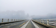Fog obscures the road as Highway 1 crosses a bridge on the Mendocino coast of California