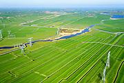 Nederland, Noord-Holland, Amsterdam-Noord, 20-04-2015; landelijk Noord en Waterland, hoogspanningsmasten tussen Zunderdorp en Ransdorp. Op deze lokatie lopen twee lijnen van het landelijk koppelnet van TenneT, het hoogspanningsnet dat landelijke elektriciteitscentrales verbindt.<br /> Powerless belonging to the nationwide high tension network. <br /> <br /> Polder and village north of Amsterdam.<br /> luchtfoto (toeslag op standard tarieven);<br /> aerial photo (additional fee required);<br /> copyright foto/photo Siebe Swart