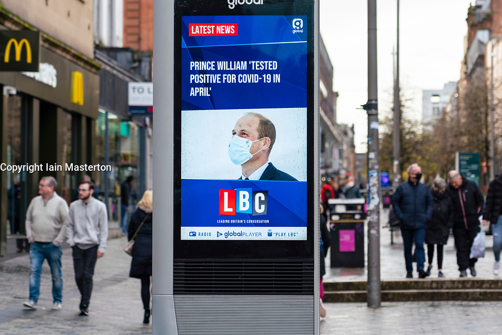 Glasgow,Scotland, UK. 2 November 2020. As Scotland enters new Coronavirus lockdown regulations the central belt and Glasgow are placed in Level 3 . Members of the public are seen out on the streets of central Glasgow for shopping and work. Pictured; Video screen shows news headlines with Prince Andrew and his positive covid-19 story. Iain Masterton/Alamy Live News