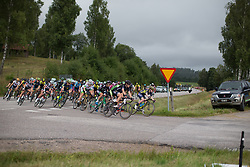 The peloton approaches the climb in the third short lap of the Crescent Vargarda - a 152 km road race, starting and finishing in Vargarda on August 13, 2017, in Vastra Gotaland, Sweden. (Photo by Balint Hamvas/Velofocus.com)