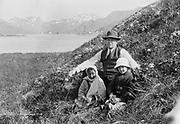 "9707-K190. ""Paul Buckley and two children on hillside near Unalaska"" June 22-24, 1917 Alaska"