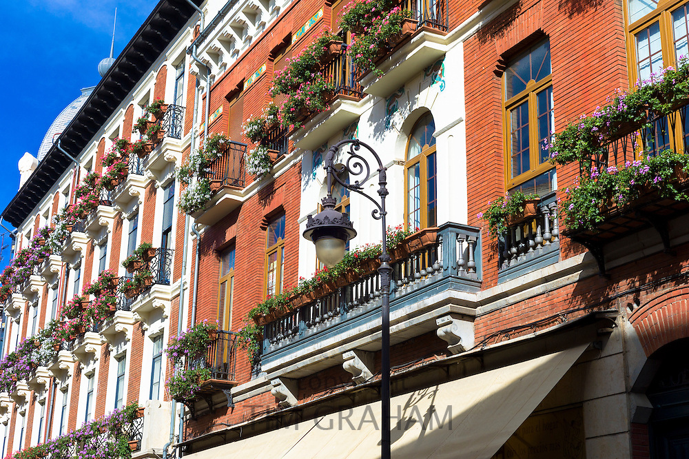 Window boxes and traditional architecture in Calle Ancha main street in Leon, Castilla y Leon, Spain