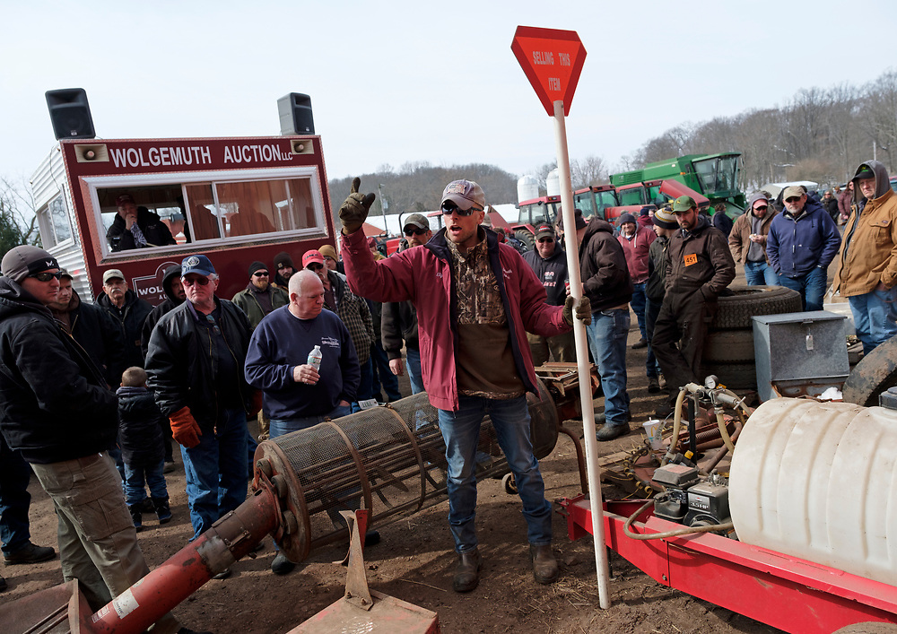 An auction is held for farm equipment on March 8, 2019, in Pittstown, New Jersey.