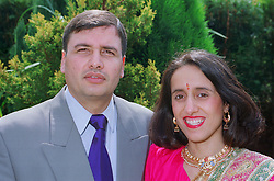 Man and woman standing together outdoors smiling,