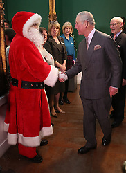 Prince Charles (known as The Duke of Rothesay when in Scotland) speaks to guests during a surprise appearance at the Dumfries House Tea Dance at Dumfries House in Cumnock.