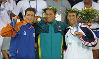 Ian Thorpe (Australia, centre) with his 200m Freestyle Gold Medal, left is Pieter van Hoogenband (Holland, Silver) and Michael Phelps (USA, bronze) Swimming, Athens Olympics, 16/08/2004. Credit: Colorsport / Andrew Cowie DIGITAL FILE ONLY