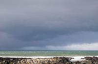 Rain clouds at the Giant's Causeway coastline in Antrim Northern Ireland