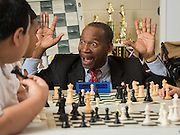 Robert Myers works with members of his The Chess Academy Knights chess team at McReynolds Middle School, May 6, 2014.