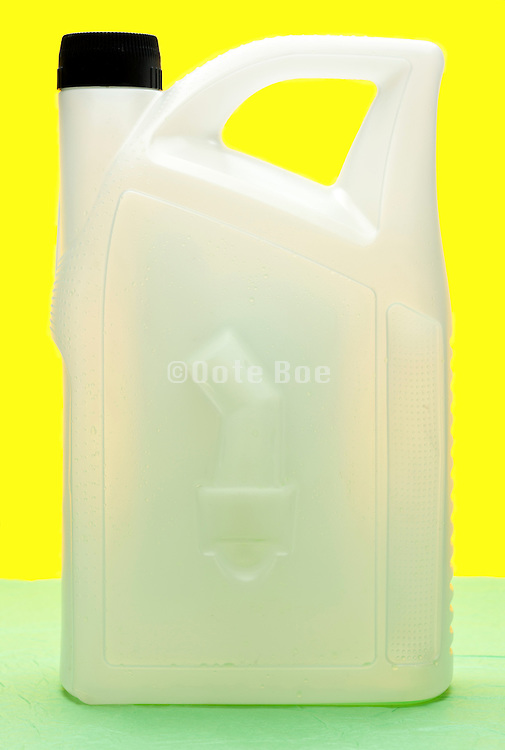 semi transparent white plastic container object on yellow green background