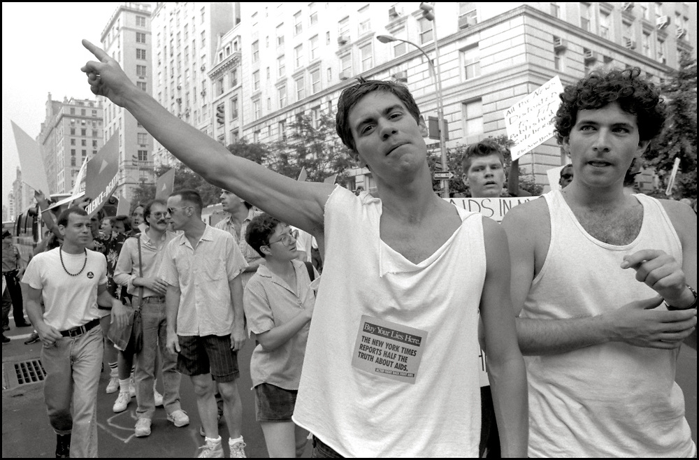 On July 25, 1989, Walter Armstrong and Sandor Katz, members of ACT UP, demonstrated in front of New York Times publisher Punch Sulzberger's residence at 1010 Fifth Avenue and then marched to West 43rd Street offices of the paper. After threatening a sit-in in Times Square, the protesters were finally allowed to picket on the sidewalk opposite the Times. Several demonstrators held a die-in in front of the building.