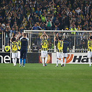 Fenerbahce's players celebrate victory during their UEFA Europa League Semi Final first match Fenerbahce between Benfica at Sukru Saracaoglu stadium in Istanbul Turkey on Thursday 25 April 2013. Photo by Aykut AKICI/TURKPIX