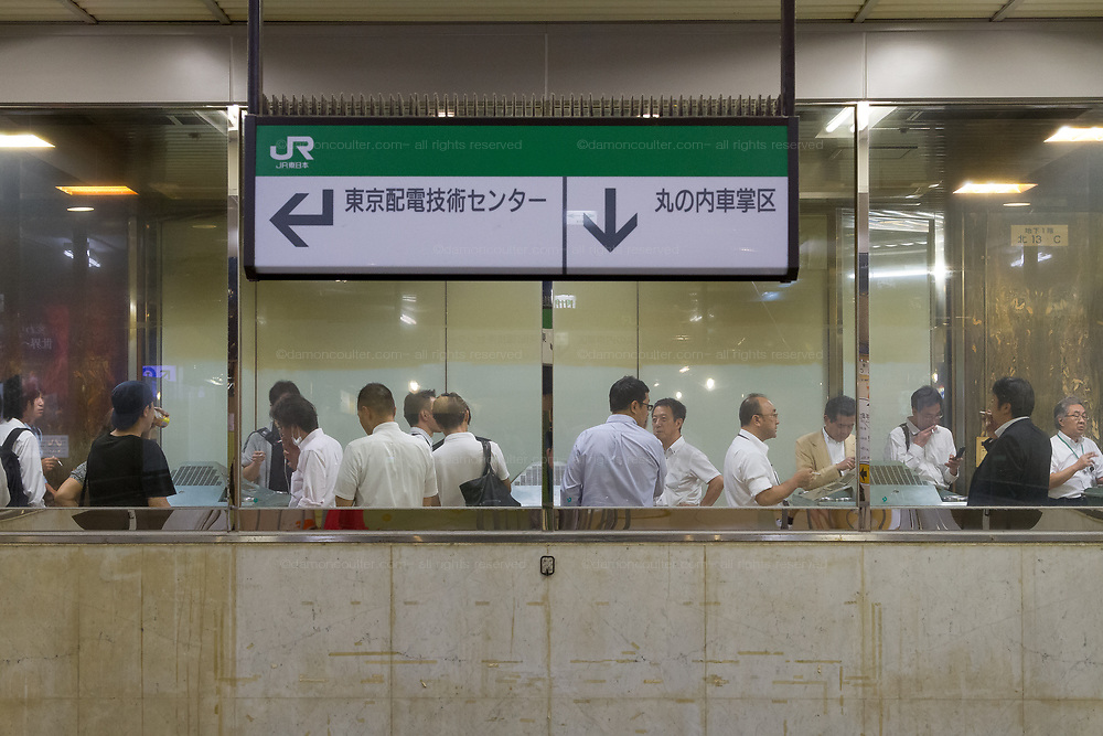A smoking room in Tokyo Station, Tokyo, Japan. Friday August 21st 2015