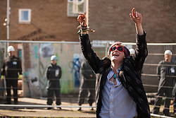 A housing activist mocks bailiffs at the Sweets Way housing estate on 23rd September 2015 in London, United Kingdom. A group of housing activists calling for better social housing provision in London had occupied properties on the 142-home estate in Whetstone, in a few cases refurbishing properties intentionally destroyed by the legal owners following eviction of the original residents, in order to try to prevent the eviction of the estate's last remaining resident and the planned demolition and redevelopment of the entire estate by Barnet Council and Annington Property Ltd.