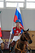 Moscow, Russia, 20/09/2003..The opening day of the Moscow Polo Club, featuring the Russian Polo Cup 2003, the first event of its kind in Russia since the 1917 Bolshevik revolution. Vladlena Bernardoni-Belolipskaya, the only Russian competitor, with national flag during opening parade.