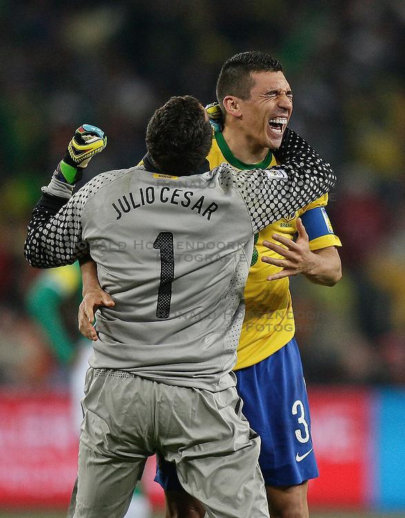20-06-2010 VOETBAL: FIFA WORLDCUP 2010 BRAZILE - IVOORKUST: JOHANNESBURG <br /> JULIO CESAR of Brazil celebrates with LUCIO of Brazil<br /> ©2010-FRH- NPH/ Vid Ponikva (Netherlands only)