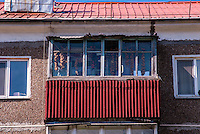 Russia, Sakhalin, Yuzhno-Sakhalinsk. Residence, onions hanged out to dry on the balcony.