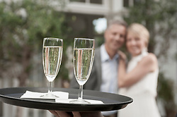 Man woman party waiter delivering champagne
