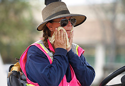 July 6, 2018 - Ramona, California, U.S. - Roller operator DANA GREEN wipes perspiration off her face as she takes a quick break from her work of preparing a road for paving near Day Street in Ramona on Friday. Record-breaking temperatures are hitting Southern California Friday. (Credit Image: © Hayne Palmour Iv/San Diego Union-Tribune via ZUMA Wire)