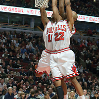 11 December 2009: Chicago Bulls forward James Johnson grabs a rebound with help from teammate Chicago Bulls forward Taj Gibson during the Chicago Bulls victory 96-91 in overtime over the Golden State Warriors at the United Center, in Chicago, Illinois, USA.