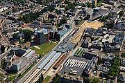 Nederland, Overijssel, Enschede, 30-06-2011;  Stationsplein, station.(dubbel eindstation) Het zeegroene gebouw (m,r) is het Stadkantoor van Enschede. Railway station Enschede. (East-Netherlands).luchtfoto (toeslag), aerial photo (additional fee required).copyright foto/photo Siebe Swart