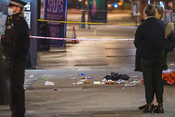© Licensed to London News Pictures. 01/01/2021. London, UK. Medical waste lays on the ground at the crime scene where two people were stabbed. Metropolitan police were contacted by London Fire Brigade at 00:32GMT on Friday 01/01/2021 to reports of a stabbing on Edgware Road.  Police officers attended the scene along with the London Ambulance Service and an advanced trauma team car from London's Air Ambulance. Two males were identified with stab injuries and taken to a major trauma centre. A women was also located at the scene suffering with a head injury, she has been taken to hospital. Photo credit: Peter Manning/LNP