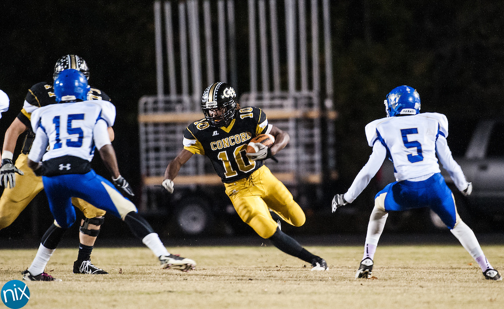 Concord's Rocky Reid carries the ball against McMichael during first round of the NCHSAA playoffs Friday, Nov. 2, 2012. Concord won the game 51-38. (photo by James Nix)
