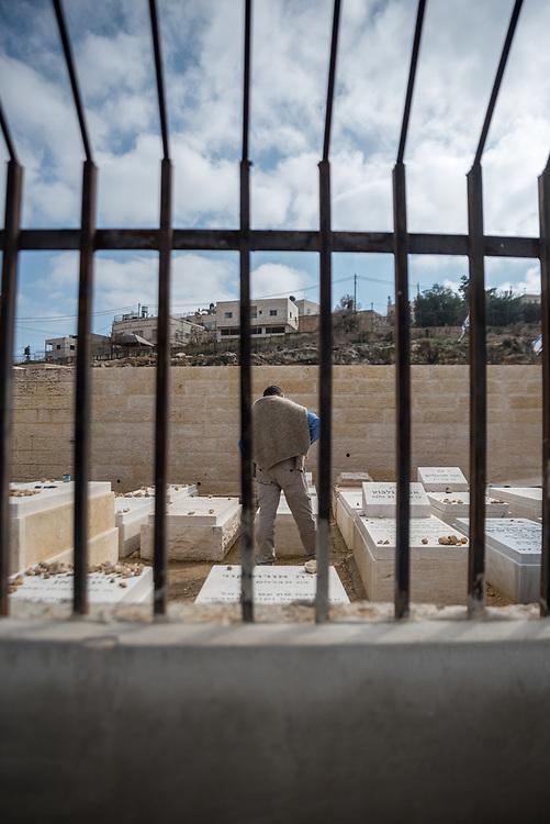 2 March 2020, Hebron: A Jewish man visits a memorial site in Tel Rumeida, Hebron.