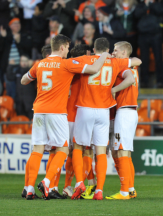 Blackpool players celebrate their opening goal <br /> <br /> Photo by Dave Howarth/CameraSport<br /> <br /> Football - The Football League Sky Bet Championship - Blackpool v Derby County - Tuesday 8th April 2014 - Bloomfield Road - Blackpool<br /> <br /> © CameraSport - 43 Linden Ave. Countesthorpe. Leicester. England. LE8 5PG - Tel: +44 (0) 116 277 4147 - admin@camerasport.com - www.camerasport.com
