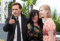 Joaquin Phoenix,  director Lynne Ramsay and Ekaterina Samsonov at the You Were Never Really Here film photo call at the 70th Cannes Film Festival Saturday 27th May 2017, Cannes, France. Photo credit: Doreen Kennedy