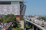 Spectators gather at the edge of the Belvedere to watch the June 10, 2016 Muhammad Ali funeral procession pause on Interstate 64 before exiting downtown at 9th Street. (Photo by Brian Bohannon)