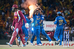 © Licensed to London News Pictures. 07/10/2012. Sri Lankan bowler Ajantha Mendis celebrates after getting the wicket of Kieron Pollard Bravo during the World T20 Cricket Mens Final match between Sri Lanka Vs West Indies at the R Premadasa International Cricket Stadium, Colombo. Photo credit : Asanka Brendon Ratnayake/LNP