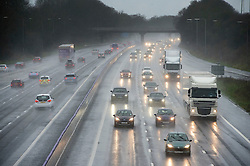 © Licensed to London News Pictures. 24/12/2015. Northampton, UK. Motorists face poor driving conditions in heavy rain on the M1 near Northampton in Northamptonshire as the Christmas getaway begins for holiday makers.. Photo credit: Ben Cawthra/LNP