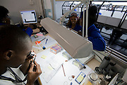 A supervisor inspects a gem in a diamond polishing factory at NamCot Diamonds in Windhoek, Namibia. Diamonds are one of Namibia's major exports, and  while conflict diamonds grab the headlines, the fact is that the industry does provide a fairly decent living for many.