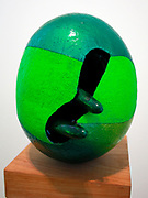 Green Egg 1962. The egg shaped forms incorporate brilliant colour combinations. Created with partly glazed and painted earthenware and painted wood.    Kenneth Price