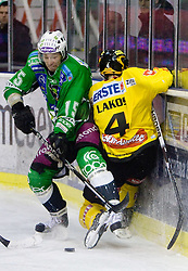 Egon Muric of Olimpija and Philippe Lakos of Vienna during 52nd Round of EBEL league ice-hockey match between HDD Tilia Olimpija, Ljubljana and EV Vienna Capitals, on February 7, 2010 in Arena Tivoli, Ljubljana, Slovenia. Vienna defeated Olimpija 8-2. (Photo by Vid Ponikvar / Sportida)