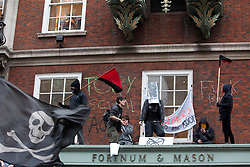 © under license to London News Pictures. 26/03/2011. Anti-Cuts Demonstration in Central London. Members of Uncut UK protesting at Fortnum and Mason's in Piccadilly. Photo credit should read BETTINA STRENSKE/LNP