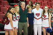 DALLAS, TX - DECEMBER 16: Former U.S. President George W. Bush and his wife Laura Bush pose with SMU cheerleaders before tipoff against the Nicholls State Colonels on December 16, 2015 at Moody Coliseum in Dallas, Texas.  (Photo by Cooper Neill/Getty Images) *** Local Caption *** George W. Bush; Laura Bush