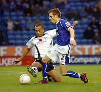 Photo: Kevin Poolman.<br />Leicester City v Fulham. The FA Cup. 06/01/2007. Alan Maybury of Leicester goes past Fulham defender Elliot Omozusi.
