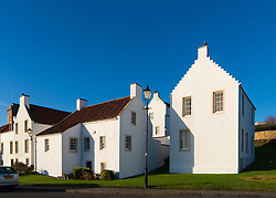 Old whitewashed seafarers houses at Pan Ha in historic village of Dysart in Kirkcaldy , Fife, Scotland, UK