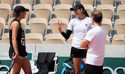 May 23, 2019 - Paris, FRANCE - Madison Keys of the United States talks to Garbine Muguruza during practice at the 2019 Roland Garros Grand Slam tennis tournament (Credit Image: © AFP7 via ZUMA Wire)