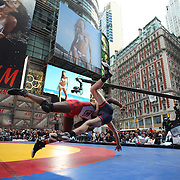 """Nate Rose, New York, and Tony Cassas, New Jersey, in action during a warm up fight before the main event the """"Beat The Streets"""" USA Vs The World, International Exhibition Wrestling in Times Square. New York, USA. 7th May 2014. Photo Tim Clayton"""