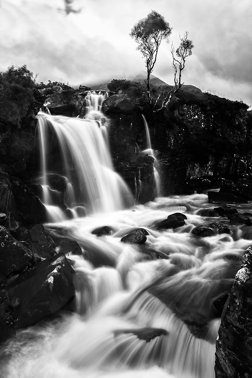 A falls cascades into Coire Mhic Nobuil, which flows into Upper Loch Torridon, in the beautiful Scottish Highlands