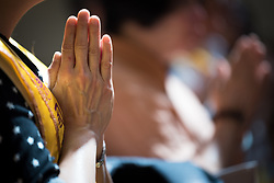 23 July 2018, Amsterdam, the Netherlands: A moment of Buddhist prayer. On 23 July, an international Interfaith Memorial and Prayer Service takes place in the Keizersgrachtkerk in Amsterdam, the Netherlands. Gathering local congregants together with international guests, the service takes place in connection with the 2018 International AIDS Conference, held in Amsterdam on 23-27 July.