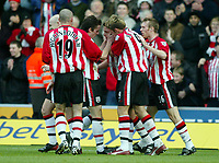 Photograph: Scott Heavey.<br />Southampton v Portsmouth. FA Barclaycard Premiership. 21/12/2003.<br />Jason Dodd is congratulated by team-mates after scoring from the corner