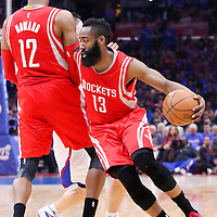 14 May 2015: Houston Rockets guard James Harden (13) drives past Los Angeles Clippers guard J.J. Redick (4) on a screen set by Houston Rockets center Dwight Howard (12) during the Houston Rockets 119-107 victory over the Los Angeles Clippers, in game 6 of the Western Conference semifinals, at the Staples Center, Los Angeles, California, USA.
