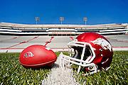 Arkansas Razorback football and helmet on the field at Donald W. Reynolds Razorback Stadium in Fayetteville, Arkansas