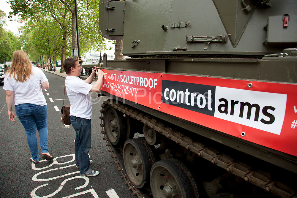 Campaigners and supporters from Oxfam and Amnesty International, as part of the Control Arms coalition, drive an Abbot gun tank around central London to highlight the need for a global Arms Trade Treaty (ATT) to be agreed during a United Nations conference next month (July 2012). London, England, UK. 27th June 2012.